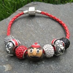 Ohio State Charm Bracelet to support the Buckeyes. Product of the day Buckeyes Football, Ohio State Football, Ohio State University, Ohio State Buckeyes, Football Stuff, Ohio State Helmet, Buckeye Crafts, The Buckeye State, Buckeye Nut