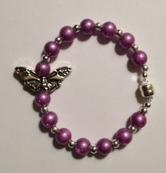 Spring 2013 Collection: 7 1/2 bracelet made with purple glass beads, silver spacer beads and a large silver butterfly bead with magnetic clasp. $19.99