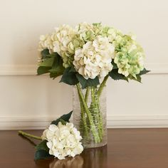 Hydrangeas These very real looking flowers have waterproof stems. Simply stand in a vase with water and no one will ever know they are fake. Also available in pink, blue a