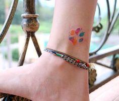 40 Most Beautiful Paw Print Tattoos Ideas