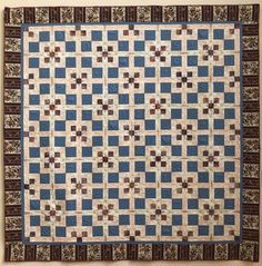"""Bed Quilt """"Signs of Our Time"""" by Sue Isaac """"I wanted to try incorporating trapunto into a quilt, but didn't want to use familiar motifs, such as flowers. So I chose the symbols we see every day. Some are products of the computer age. Others are timeless. Quilt Bedding, Capital City, Symbols, Age, Quilts, Blanket, Signs, Flowers, Products"""