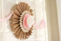 """Oh, I used the same method to make this huge stacked lollie using brown butcher paper, old book pages, pink cardstock and topped with a little flower made from cupcake liners, complimented with a pleated pink crepe paper streamer. Love it!!"""