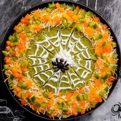 Halloween Spider Web Dip is a spooktacular layered dip that will have all the Ghouls and Booys dipping away to their heart's content. This Tex-Mex style appetizer is quick to assemble and so much fun to decorate. Having a Halloween party? Here's how to turn a classic layered Tex Mex style dip into a treasured Halloween tradition. Your family and guests will delight in each layer of this frightfully fabulous appetizer. However, it's the spooky sour cream spider web that will lure them in, along w