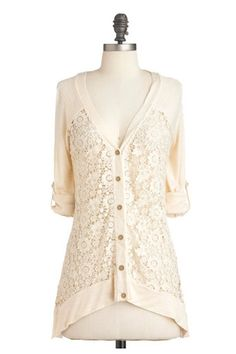ModCloth Return of the Macchiato Cardigan - the modern silhouette and slinky jersey fabric of this pretty little summer cardi contrast pefectly with the Victorian vibe of ivory lace. The richly ornate floral weave of the lace insets provides a cool airiness essential for the heat of summer. Flirty, feminine, and subtle, this cardigan is the ideal mix of casual comfort and sophisticated beauty.