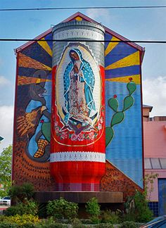 World's Largest Virgin Mary Mosaic Candle ~ built in 2004 by artist Jesse Trevino in San Antonio, Texas. The mosaic is a 40 feet tall replica of the Virgin of Guadalupe candle with an eternal flame on top.