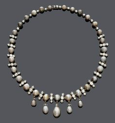 Lot 2190. Natural pearl and diamond necklace, about 1900. Estimate CHF 70 000/100 000 (€ 64,810 / 92,590). Photo Koller  Silver yellow gold, total 59g. Apartes Collier, showcases 29 bouton-shaped, round and slightly oval, gray natural pearls in the course, of approximately 5.6 to 9.5 mm Ø, or diamond-set intermediate parts. On the face side 5 different sizes Pendentifs, with diamond-attach it and 1 drop-shaped natural pearl of 10 x 7 to 16 x 11 mm. Total weight of the 67 old cut diamonds…