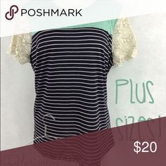 Crochet Accent Sleeve Top This comfortable cute top has a crochet sleeve, turquoise yolk, and a black and white striped torso. Tops Blouses