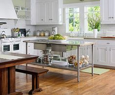 """""""A stainless-steel restaurant-style island adds a contemporary edge to this vintage kitchen."""""""
