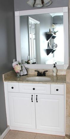 DIY bathroom makeover: painted countertop, painted fixtures, framed mirror