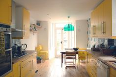 Beautiful yellow kitchen, home of Francesca of Mrs Eliot Books.