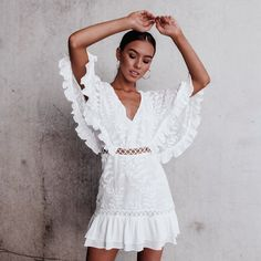 Frills and ruffles: white mini dress with ruffles and frills, the perfect some dress, vacation dress or party dress.