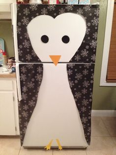 Turn your fridge into a penguin with wrapping paper!