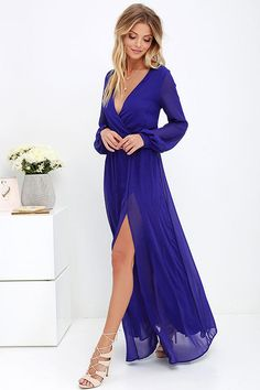 Take a moment to marvel at the sheer beauty of the Wondrous Water Lilies Royal Blue Maxi Dress! Royal blue chiffon shapes a surplice bodice framed by sheer long sleeves. A billowing maxi skirt with front slit falls below the elasticized waist for a stunning finish.