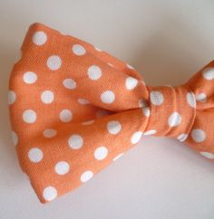 Boy's Coral Polka Dot Bow tie - clip on. $12.00, via Etsy.  Max