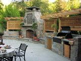 Outdoor kitchen and Fireplace - traditional - landscape - other metros - by The Collins Group