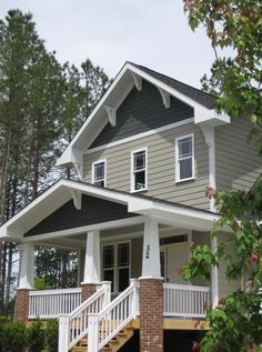 Great use of Monterey Taupe on this home's exterior, Iron grey and arctic white Hardie board