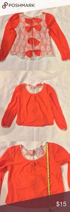 Orange top with bows Lace back with bows. Would make great Clemson or UT Vols game top! by stella Tops Blouses
