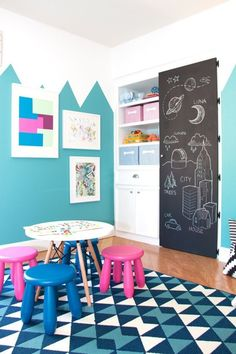 """A Mountain of Fun Playroom — Professional Project   Apartment Therapy - I love the """"mountain"""" outline in paint on the walls and the chalkboard door!"""