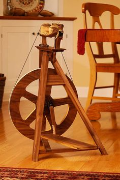 Lovely little folding spinning wheel from Overland Handcraft - this would be a great first wheel, I think.