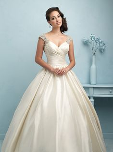 Allure Bridals, 9204; Designed for the princess, this taffeta ballgown is finished with Swarovski crystal encrusted cap sleeves and V back.