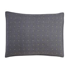 Theo Sham | A solid graphite, chambray ground is brought to life with delicate cross-stitch pop color details on the Theo sham. Pair with the matching Theo quilt for a cozy and stylish look.