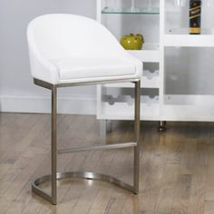 This curvaceous bar stool hits all the right notes, with textures that flow gracefully from one to another. With a soft seat and sturdy metal base, this chair seems to hover above the ground. A stylish illusion you have to see to believe. Brushed Stainless Steel Finish Cover Seat in Leatherette...