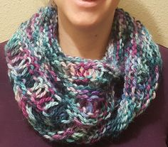 This seamless moebius cowl is a creative way to show off a few fun techniques in a quick project that makes a great gift! It is worked in the round either on long circular needles (minimum 32 inch long). Small/Medium fits a teen or adult with options for a bulkier, close-fitting look or a more relaxed look. Larger sizing is available for those who desire an even looser look and fit. The drop stitches add to the loft of the cowl, helping it to keep the wearer warm and cozy. This is a…