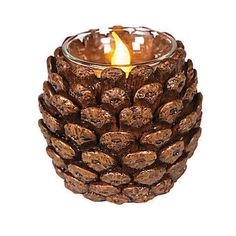 Pinecone Votive Holder Bring the feel of winter and the holidays to your tables. Just add battery-operated candles and enjoy the soft, flickering glow. Buy a few as Christma . Pine Cone Art, Pine Cone Crafts, Pine Cones, Pinecone Crafts Kids, Acorn Crafts, Pinecone Ornaments, Nature Crafts, Fall Crafts, Holiday Crafts