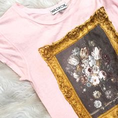 Wildfox pink floral tee Super chic and romantic light pink tee with floral frame design and distressed edging. Tag says xs but is one of those one size fits most type of tops. Great condition! Wildfox Tops Tees - Short Sleeve