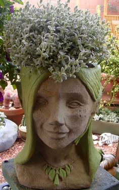 """Concrete Fairy Head Planter Create a """"fairy"""" head planter. Just fill our durable, decorative fairy head with succulents and create a center piece for your porch or patio areas. Large Garden Pots, Garden Planters, Succulents Garden, Garden Art, Balcony Garden, Face Planters, Concrete Planters, Ceramic Planters, Garden Statues"""