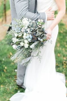 blue and white bouquet - photo by Ashley Errington Photography http://ruffledblog.com/dusty-blue-winter-winery-wedding