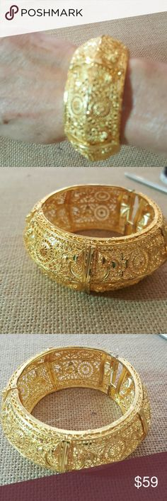 24ct gold plated braclet This is! so beautiful, alot of filigree work., not sure what the metal underneath is, but does not turn, have alot of pieces from this buyer, never had problems. Jewelry Bracelets