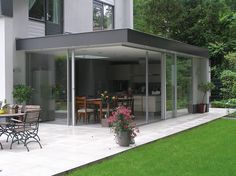 Love how these floor to ceiling glass doors bring a house and it's garden together! Bungalow Extensions, House Extensions, House Extension Design, House Design, Pergola, Porch Veranda, House Blueprints, Exterior Remodel, Home And Deco