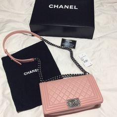 Chanel Boy bag Light Pink Medium Lamskin 100% Authentic Chanel Boy Bag Light Pink Medium Lambskin with silver hardware. In excellent condition. Very clean in the interior and exterior. No stains or smells. 9/10 condition. Sign of used on the 4 corners as shown in pictures. Please email me for more pictures and ️️ price missytieu@aol.com . Comes with original box, dust bag, and authenticity card. NO TRADES, THIS ITEM IS NOT ELIGIBLE FOR BUNDLE DISCOUNT CHANEL Bags Crossbody Bags