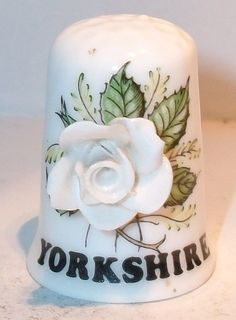 A BIRCHCROFT FINE BONE CHINA APPLIED FLOWER THIMBLE DEPICTING THE YORKSHIE ROSE