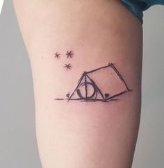 My first tattoo, the Perkins tent with a Deathly Hallows entrance, over a starry night sky with the stars from the pages of all the books
