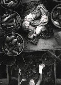 Baby on Cucumber Machine, Kent County, Ontario, Canada. Photo by Larry Towell