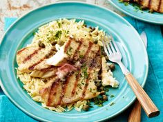 Get this all-star, easy-to-follow Grilled Tilapia with Lemon Butter, Capers and Orzo recipe from Bobby Flay