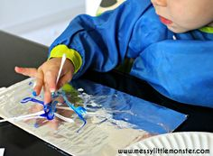 Painting on foil using q tips. Fine motor skills for toddlers and preschoolers.