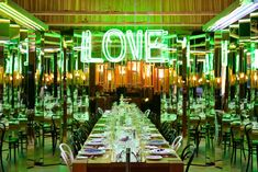 """Design Agency built a whimsical setting filled with neon lights and mirrors. The goal of the installation, according to a company rep, was to let diners """"experience many other angles of each other."""""""