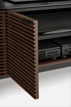 The award-winning Corridor 8179 home theater media cabinet features louvered doors, a satin-etched black glass top and large adjustable storage compartments.