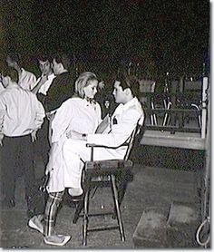 Elvis getting cozy with costar Ursula Andress between filming scenes of Fun in Acapulco.