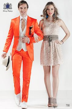 Orange cotton satin suit with notch lapel with 2 buttons closure. Flap pockets and straight buttonholes. Twin vents at back, style 798 Ottavio Nuccio Gala, 2015 Fashion Collection.
