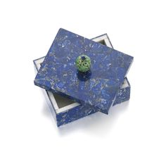 PROPERTY OF A LADY OF TITLE Lapis lazuli and jade box, Cartier, circa 1945 The rectangular box covered in mosaic lapis lazuli, topped by a removable lid capped with a carved jade rondelle surmounted by a piece of facetted lapis,