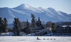 19 Stunning Natural Ice Skating Rinks Around the World- shown- Mirror Lake at Lake Placid, New York Lake Placid Olympics, Taos Ski Valley, Jackson Hole Mountain Resort, June Lake, Mirror Lake, Sustainable Tourism, Lake City, Weekend Getaways, Travel Usa