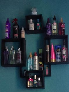 use really cool and unique bookshelves or wall organizers (like this one from bed bath and beyond) to hold perfumes, hair products, and other girly spray bottles.