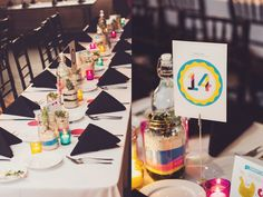 Creative decor - a CMYK wedding!  Love the potted succulent centerpieces that doubled as favors.