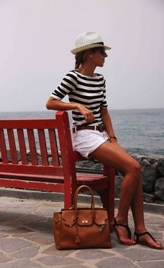 Laid-back, chic nautical look: striped knits, fedora, and divinely luxe tote.