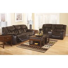 Ashley Tafton Java Two Piece Reclining Sofa Set - With the rich brown tones of the soft upholstery fabric and the faux leather upholstery beautifully blending together, the Tafton-Java upholstery collection features the comfort of chaise pad seating along with plush padded arms and divided backs to create the ultimate in comfort and style for your living area.