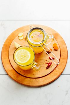 A 5-minute, 3-ingredient tea tonic with ginger, lemon, turmeric, and cayenne. The perfect way to detox the body, heal from a cold, or relax before bed.